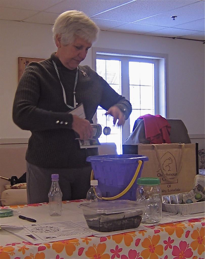 Demonstrating the art of paper pot making.