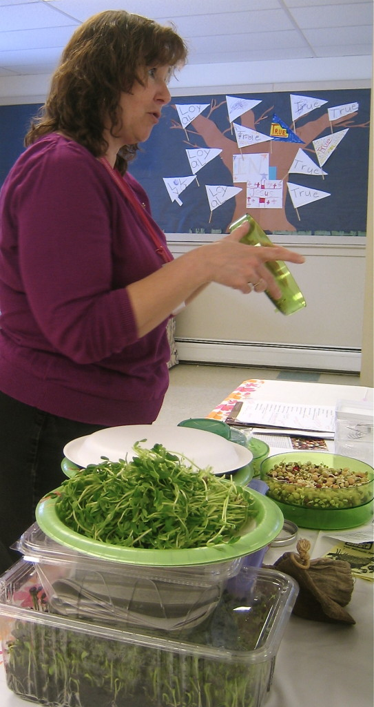 Patti showing how to grow sprouts and shoots.